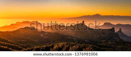 Sunset from the top of Gran Canaria Island. Pico de las Nieves. As main subject you can see the Roque nublo and the Teide in Tenerife Island. #1376981006