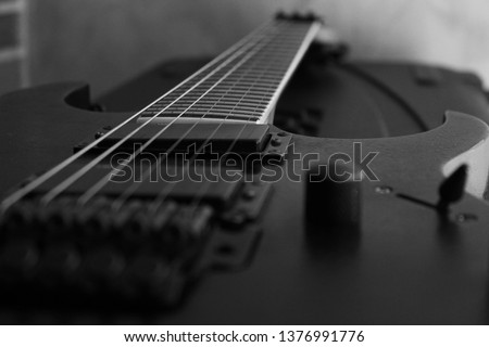 Close-up of electric guitar in black and white.  #1376991776