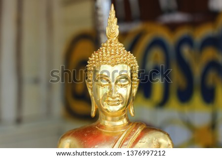 Close-up image, face, Buddha image in a beautiful golden buddhist religion #1376997212