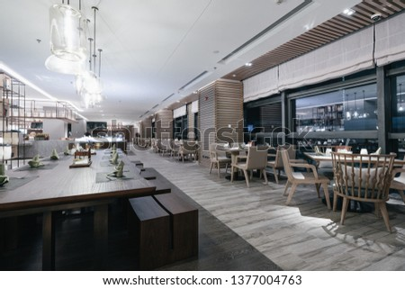 Restaurant interior, part of hotel, fresh and simple design style. #1377004763