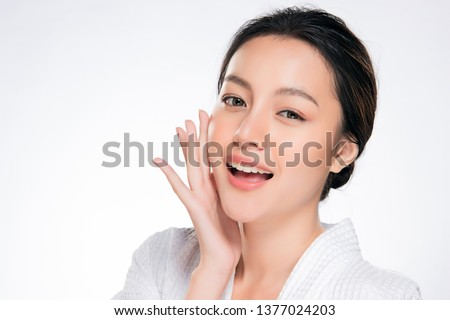 Beautiful Young Woman with Clean Fresh Skin. Face care . Facial treatment . Cosmetology , beauty and spa. Asian women portrait #1377024203