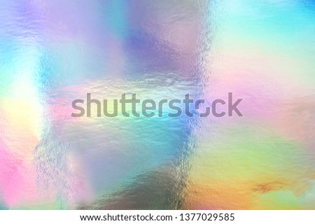 Holographic foil paper close-up. Modern trendy colorful background #1377029585