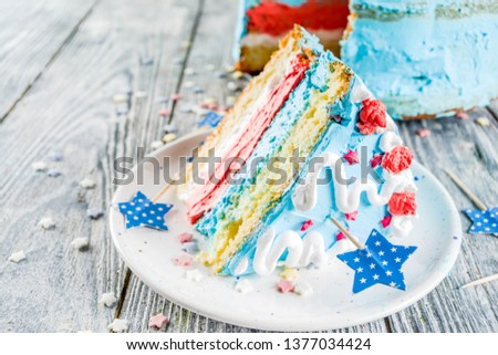 Homemade American United States  Independence day cake, for 4 July party, with sugar stars, striped cream decoration, wooden background copy space #1377034424