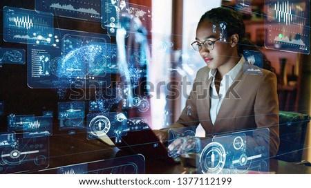Young femal e engineer concept. GUI (Graphical User Interface). Royalty-Free Stock Photo #1377112199