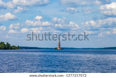 Summer landscape: River, sky, clouds, Church bell tower on the water #1377257072