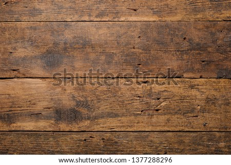 Dark old wooden table texture background top view Royalty-Free Stock Photo #1377288296