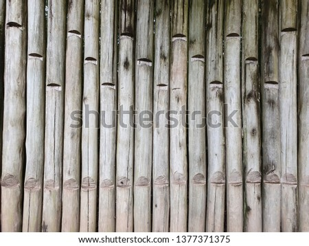 wall with wooden poles #1377371375