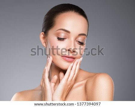 Beauty skin woman face clos up healthy hair and skin cosmetic natural makeup happy model emotional face manicure nails hand #1377394097