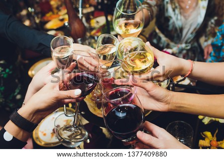 Champagne glasses in hands of people at party. Royalty-Free Stock Photo #1377409880