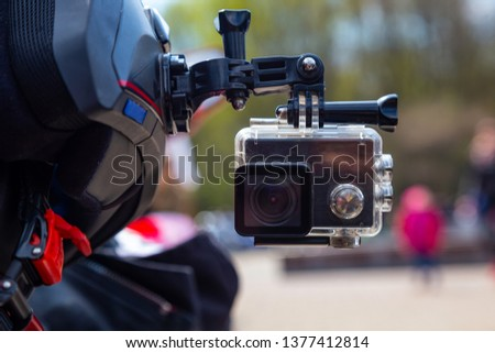 Action camera on a motorcycle rider's helmet. #1377412814