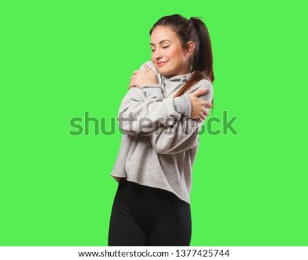 Young fitness woman giving a hug #1377425744