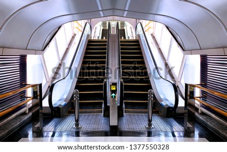"""April 7, 2019 - Bangkok,Thailand :: Symetrical short escalators in a parking lot of """"Fortune Tower"""" an famous electronics shopping mall at """"King Rama 9 road"""" #1377550328"""