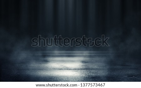Empty background scene. Dark street reflection on the wet pavement. Rays of blue neon light in the dark, neon figures, smoke. Night view of the street, the city. Abstract dark background. #1377573467