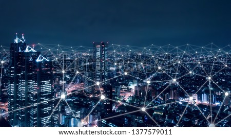 Telecommunication network above city, wireless mobile internet technology for smart grid or 5G LTE data connection, concept about IoT, global business, fintech, blockchain #1377579011