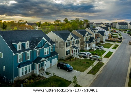 Aerial view of typical American new construction neighborhood street in Maryland for the upper middle class, single family homes USA real estate #1377610481