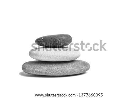 Sea pebble. Group of smooth grey and black stones. Pebbles isolated on white background #1377660095