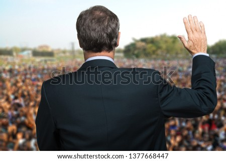 Politician talking and making an oath with his arm raised #1377668447
