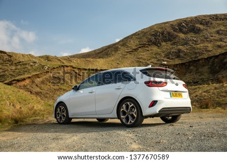Skye, Scotland - April 9, 2019: View of a white 2019 Kia Ceed on the road in the Isle of Skye. #1377670589