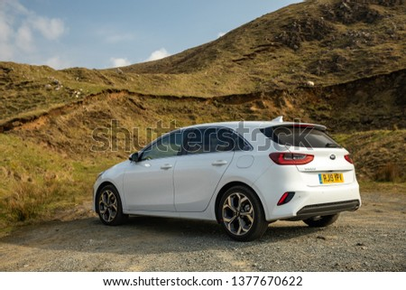 Skye, Scotland - April 9, 2019: View of a white 2019 Kia Ceed on the road in the Isle of Skye. #1377670622
