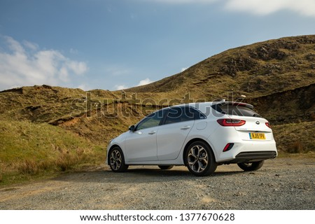 Skye, Scotland - April 9, 2019: View of a white 2019 Kia Ceed on the road in the Isle of Skye. #1377670628