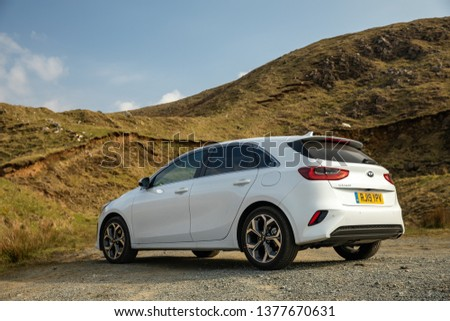 Skye, Scotland - April 9, 2019: View of a white 2019 Kia Ceed on the road in the Isle of Skye. #1377670631