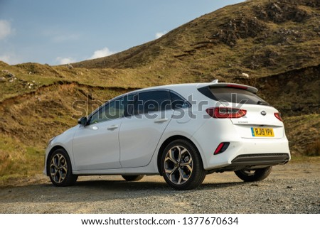 Skye, Scotland - April 9, 2019: View of a white 2019 Kia Ceed on the road in the Isle of Skye. #1377670634