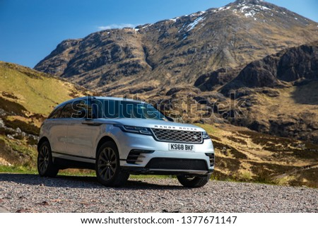 Skye, Scotland - April 9, 2019: View of a white 2018 Range Rover Velar on the road in the Isle of Skye. #1377671147
