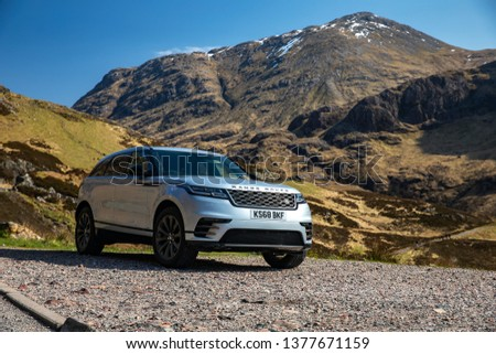Skye, Scotland - April 9, 2019: View of a white 2018 Range Rover Velar on the road in the Isle of Skye. #1377671159