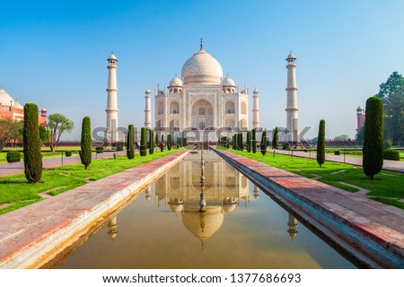 Taj Mahal is a white marble mausoleum on the bank of the Yamuna river in Agra city, Uttar Pradesh state, India #1377686693