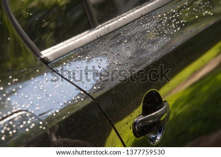 The photo is blurred, raindrops on the car paintwork #1377759530