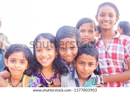 VARKALA, KERALA, INDIA - DECEMBER 15, 2012: Portrait smiling indian children on Varkala during puja ceremony on holy place - on the Papanasam beach #1377803903