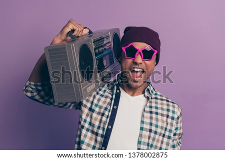 Closeup photo portrait of positive glad optimistic handsome ecstatic funny funky careless in modern street outfit millennial enjoying loud sound from casette player isolated violet background #1378002875