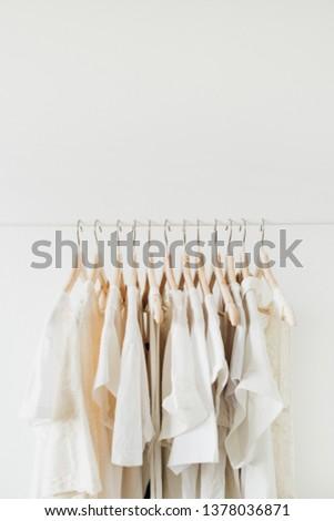 Feminine clothes on hanger. Minimal fashion composition on white background. Lifestyle concept. #1378036871