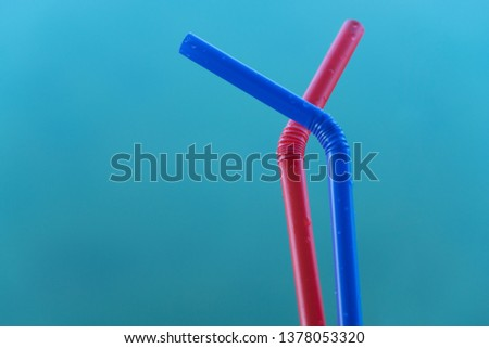 red and blue plastic straw on green blue water background for drink or environment conservation background #1378053320