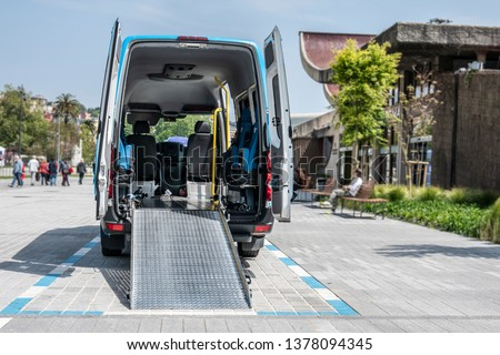 moving van with ramp for the transport of disabled people  or van to transport disabled people or mobility van for disabled people or van for handicapped people  #1378094345