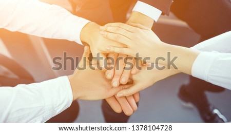 Male And Female Crossed Hands In Sunlight. Expressing Partnership. Business Partnership Concept. #1378104728