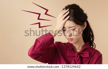 Young woman having a headache.