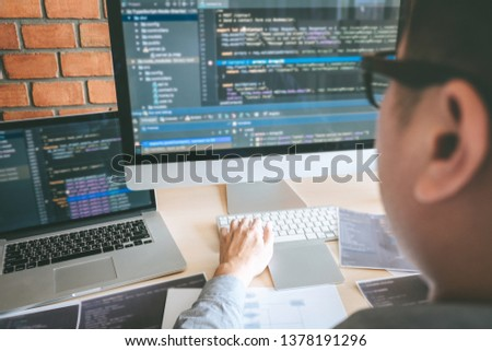 Professional Developer programmer working a software website design and coding technology, writing codes and database in company office, Global cyber connection technology. #1378191296