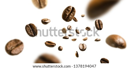 Coffee beans in flight on white background Royalty-Free Stock Photo #1378194047