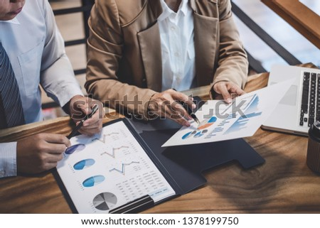 Business team colleague working with new startup project plan and discussion information for financial strategy with laptop, results of their successful teamwork. #1378199750