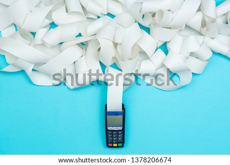 POS terminal with very long receipt, expensive shopping concept Royalty-Free Stock Photo #1378206674