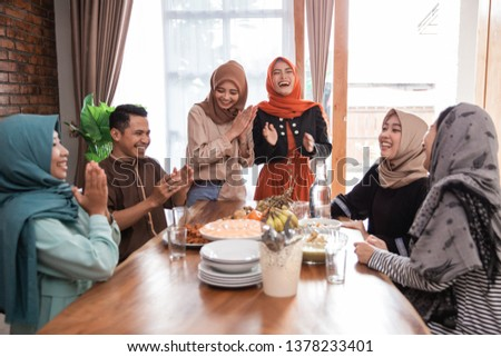 muslim friend and family laughing together while having lunch together at home #1378233401