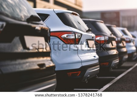 cars parked in row on outdoor parking #1378241768