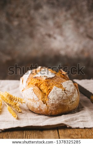 Fresh homemade crisp bread on wooden background. French bread. Bread at leaven. Unleavened bread #1378325285