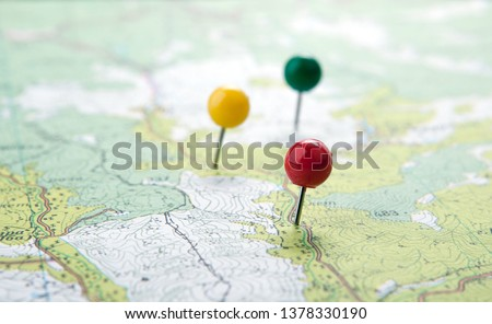 topographic map with colored needles pushpins Royalty-Free Stock Photo #1378330190