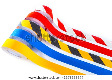 Attention emergency tapes. Fluorescent protective adhesive strips. Signal tape for emergency fencing. Reflective devices to improve visibility. Reflective strips of overalls. Royalty-Free Stock Photo #1378335377