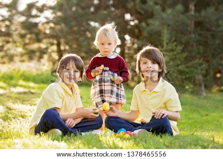Sweet children, boy brothers with bunny ears, egg hunting for Easter, child and Easter day traditions. Kids and holidays #1378465556