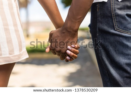 Close up outdoor protrait of black african american couple holding hands #1378530209
