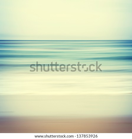 An abstract ocean seascape with blurred panning motion.  Image displays a retro, vintage look with cross-processed colors.