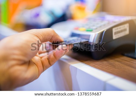 Hand put credit card In slot of credit card reader, credit card payment, buy and sell products & service, the concept of payment without cash, selective focus. #1378559687